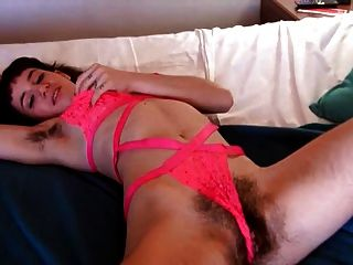 Hairy Brunette In Bed Playing With Herself