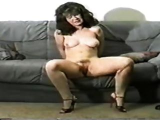Slave endures being suspended by her breasts 1