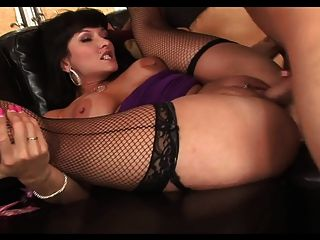 Horny Cougar In Fishnet Fucks On The Sofa