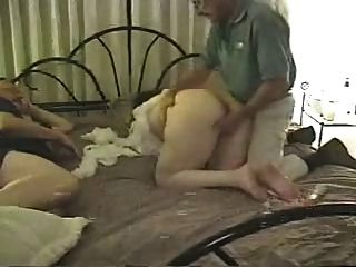 Mature Couple In Bed With A Friend