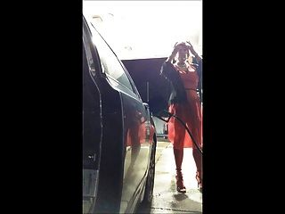 Gas Station In A Red Dress On A Windy Day