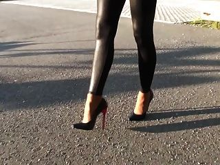 Girl In Leggings And Sexy High Heels