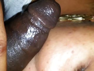 Hung black stud lounges on the couch and gets his hard cock deepthroated 4