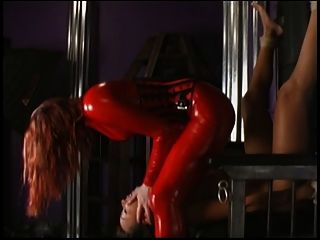 Fetish Lesbians Scene With Chick In Red Latex