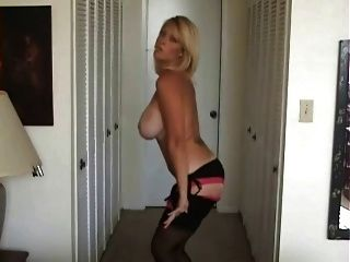 Blond Babe Smokes And Strips From Lingerie