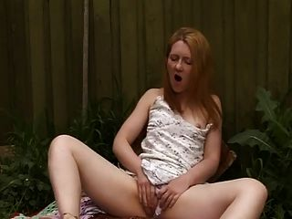 Ginger Minge Plays In The Garden