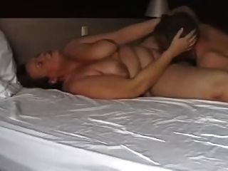 Mature Couple Playing In Bed