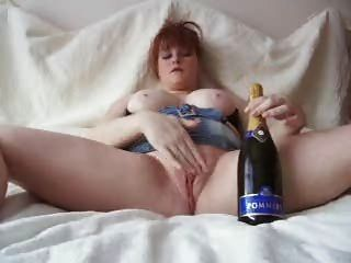 Redhead Fucking A Champagne Bottle