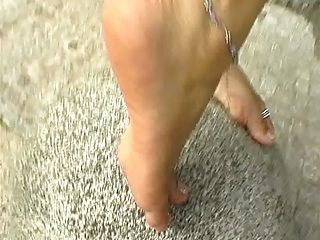Slavegirl Shows Off Her Bare Feet.