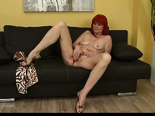 Mature Redhead Plays With Her Pussy