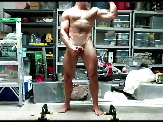 Dad Practicing His Posing Routine In The Garage