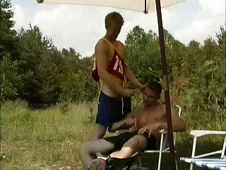 Blond Fucked By Two Guys In Woods