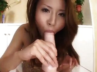 Sexy Asian Sucks And Fucks Her Dildo