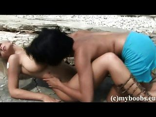 Busty Lesbian Play On The Beach