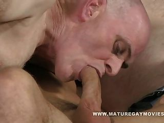 Two Hot Mature Guys Share A Young Cock