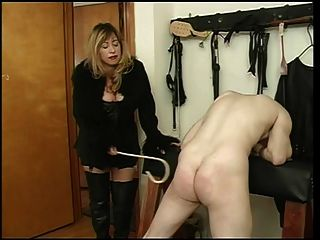 Mistress Cristian Spanking Her Slave Dude
