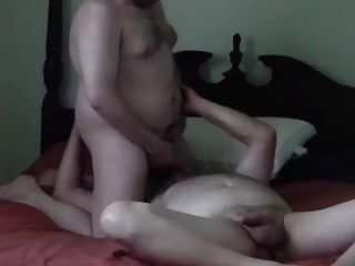 Grandfather And Younger Play On Bed