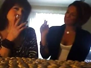 Young Girl Smokes Cigarettes With Mom