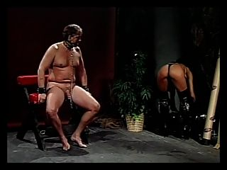 Guy Gets Punished By Randy Chick In Leather