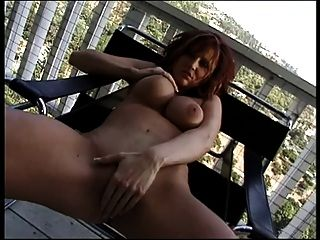 Busty Redhead Fucks Her Pussy With Double Headed Dildo On High Wooden Balcony