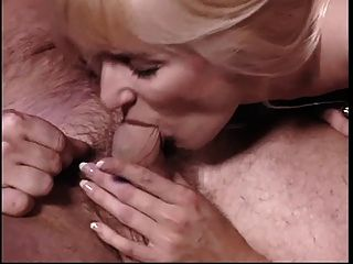 Blonde With A Nice Rack Takes On 2 Big Cocks