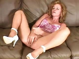Mature In Pantyhose Rubs Her Cunt Generously