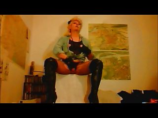 Madame Crudelitas In Boots And Fishnet Tights