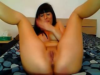 Lusty Brunette Dildos Herself On Cam