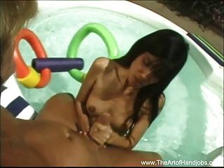 Asian Gives Handjob By The Pool