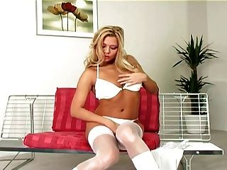Pretty Blonde Rubs Her Pussy In Boots And Stockings