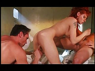 Busty Redhead Gets Filled With Cock In Her Cunt And Ass Hole And Swallows Loads
