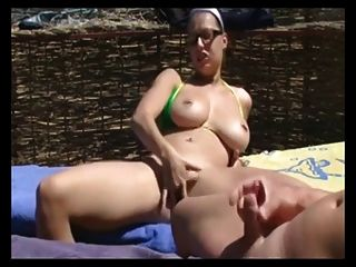 Masturbation And Blowjob On The Beach