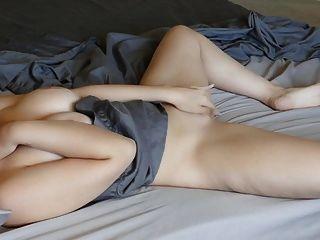 Girl Masturbating On The Bed