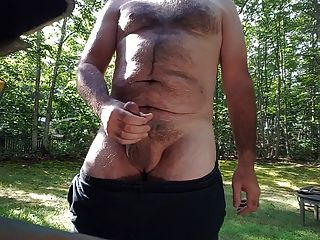 Jerking Off Outdoors In Back Yard Cum Shot Public