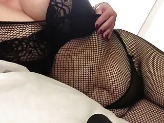 Sexy Granny Big Tits Chilling In Fishnets