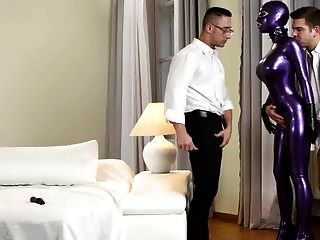 Two Guys Fuck Slut In Purple Latex Cat Suit With Facial
