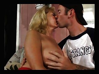 Big Titty Mature Fucks With A Young Boy