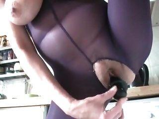 Mature Woman Masturbating In The Kitchen