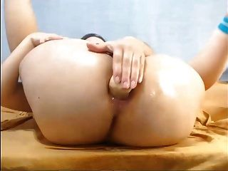 Busty White Babe Shoving A Dildo In Her Ass With Oil