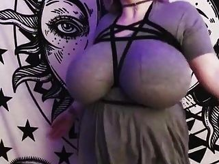 Shaking Her Huge Clothed Tits