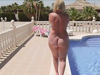 A Mature Woman With A Naked Round Ass Walks By The Pool